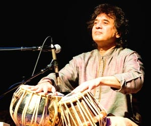 ustad zakir hussain Tabla maestro ustad zakir hussain is nothing short of an icon in the classical  indian music firmament a child prodigy born to another legend,.